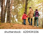 happy young family walking and... | Shutterstock . vector #620434106