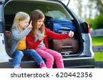 two adorable little sisters... | Shutterstock . vector #620442356
