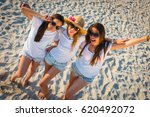group of three beautiful young... | Shutterstock . vector #620492072