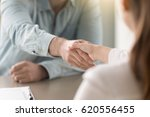businessman shaking female hand ... | Shutterstock . vector #620556455