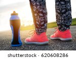 closeup of runner's shoes and... | Shutterstock . vector #620608286