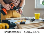 Man Changing Drill Bit On A...