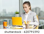 young woman working on a... | Shutterstock . vector #620791592