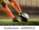 soccer player hits a ball | Shutterstock . vector #620903516