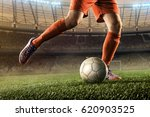 soccer player hits a ball | Shutterstock . vector #620903525