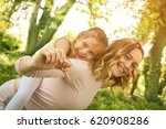 mother and daughter outdoors in ... | Shutterstock . vector #620908286
