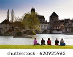 Small photo of Moret-sur-Loing, France - March 26, 2017:Group of tourists sitting near Loing river. This town was a source of inspiration for Monet, Renoir and Sisley.