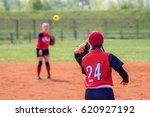 Two Softball Girls Throwing Th...