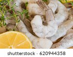 frozen raw shrimp with tails on ... | Shutterstock . vector #620944358