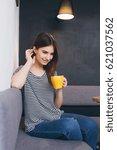 young beautiful girl drinking... | Shutterstock . vector #621037562
