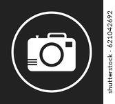 camera icon on black background.