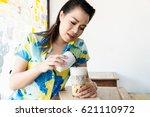 beautiful young woman relaxing... | Shutterstock . vector #621110972