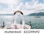 wedding arch on the beach in... | Shutterstock . vector #621249692