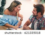 young couple sitting in a cafe... | Shutterstock . vector #621335018