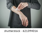 man use cotton and wipe his arm | Shutterstock . vector #621394016