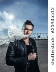 man is vaping n the square in...   Shutterstock . vector #621435512