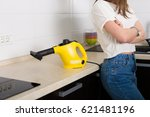 young beautiful woman cleaning... | Shutterstock . vector #621481196