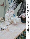 restorer fixes white marble...   Shutterstock . vector #621483296