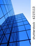 Office building details reflecting, blue sky in geometric windows - stock photo