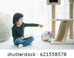 Stock photo cute asian child playing with kitten 621558578