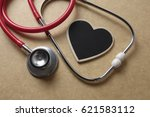 red stethoscope and black heart ... | Shutterstock . vector #621583112