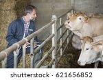 Attractive Farmer In Barn Usin...