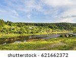 rural landscape with village on ... | Shutterstock . vector #621662372