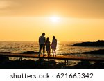 silhouette of parents with a... | Shutterstock . vector #621665342