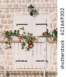 white window shutters. the...   Shutterstock . vector #621669302