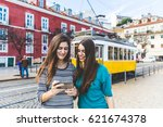 two girls in lisbon with the... | Shutterstock . vector #621674378