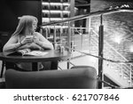 picture of young lady sitting... | Shutterstock . vector #621707846