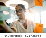 asian businesswoman looking... | Shutterstock . vector #621736955