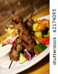 lamb kebabs with a side salad | Shutterstock . vector #62174095