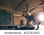 strong man pushing heavy bogie... | Shutterstock . vector #621761342