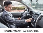 man driving car with navigation ... | Shutterstock . vector #621820106