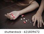 pills on female hands   suicide ... | Shutterstock . vector #621839672