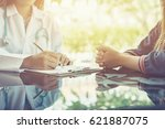 asian female doctor and patient ... | Shutterstock . vector #621887075