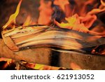 firewood burning with a bright... | Shutterstock . vector #621913052