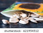 sunflower seeds spilled from a... | Shutterstock . vector #621954512