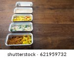 row of take away dishes in foil ... | Shutterstock . vector #621959732