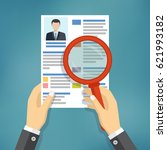 hands holding a resume and... | Shutterstock .eps vector #621993182