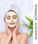 spa woman applying facial clay... | Shutterstock . vector #621994616