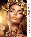 gold woman holiday makeup.... | Shutterstock . vector #622012016