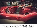 mechanic working on car body... | Shutterstock . vector #622021166