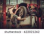 mechanic working on classic car ... | Shutterstock . vector #622021262