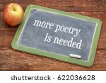 Small photo of more poetry is needed- words on a slate blackboard against red barn wood