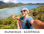 young male hipster traveler... | Shutterstock . vector #622054616
