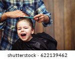 a little boy is trimmed in the... | Shutterstock . vector #622139462