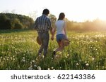 couple of young people walking...   Shutterstock . vector #622143386
