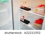 open refrigerator with plastic